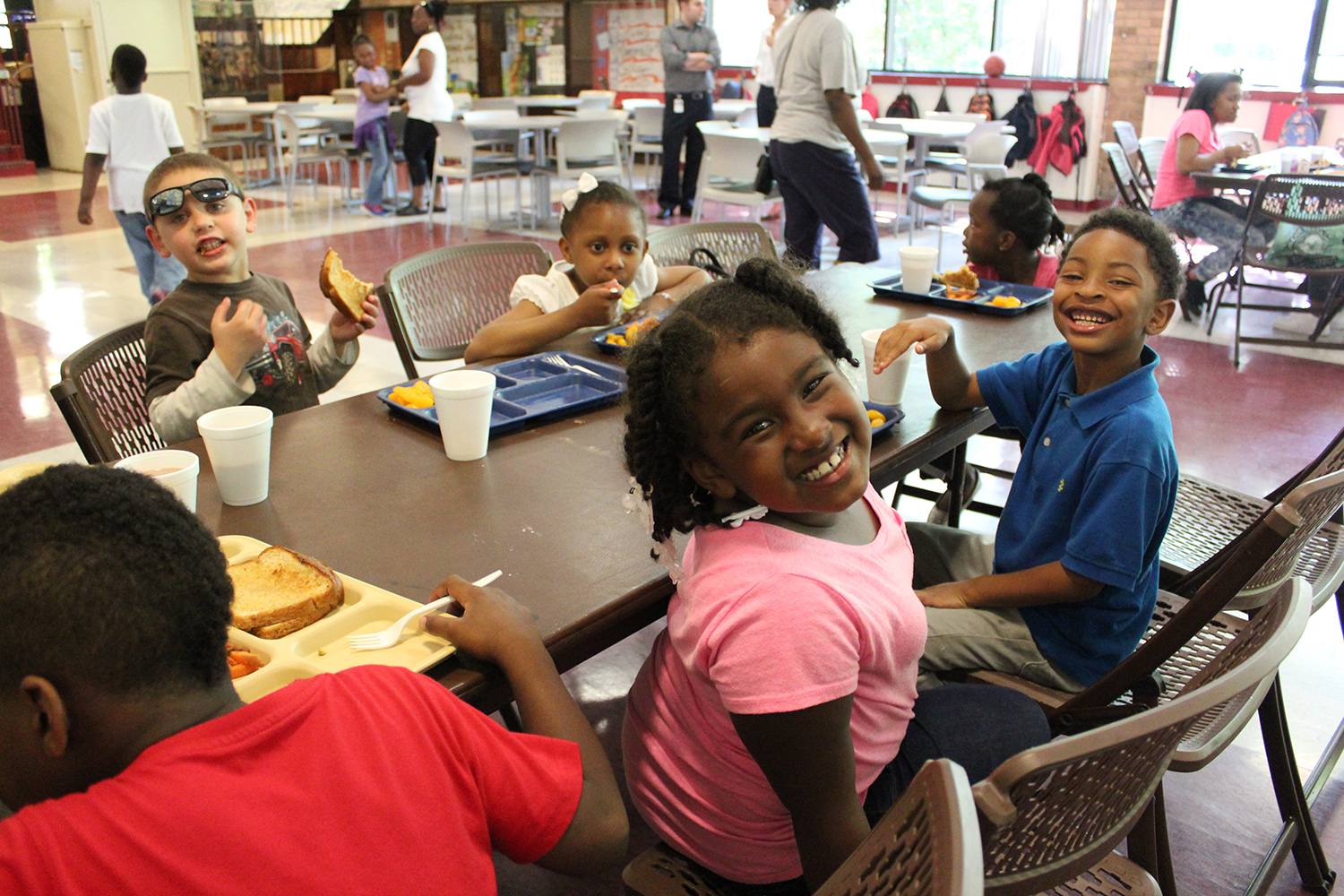 The children are all smiles at the Fleetwood Jourdain Community Center in Evanston after receiving eating an after-school meal.  The City of Evanston, sponsor of the Center's At-Risk After-School Meals program is a recent recipient of a No Kid Hungry after-school meals expansion grant.